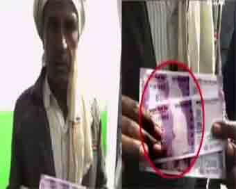 Mahatma missing from Rs 2,000 notes withdrawn from MP bank