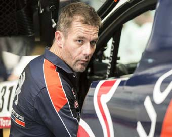 Loeb wins Dakar Rally stage 2, takes overall lead