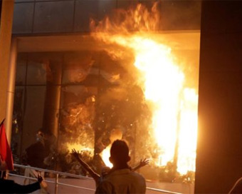 Protesters set Paraguayan parliament building on fire