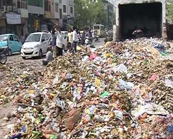 MCD sanitation workers dump muck on streets, go on strike