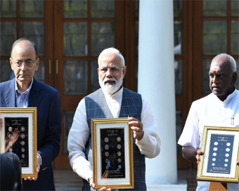 Modi releases visually impaired friendly coins