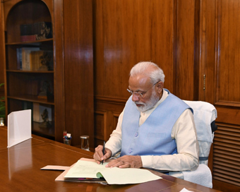 Modi asks ministers to reach office on time, avoid working from home