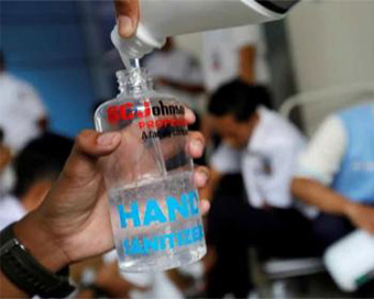 Andhra official drinks sanitiser, mistaking it for water
