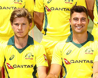 Adam Zampa and Marcus Stoinis meditate together
