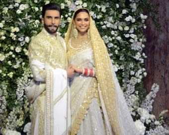 Ranveer, Deepika all smiles at Mumbai wedding reception