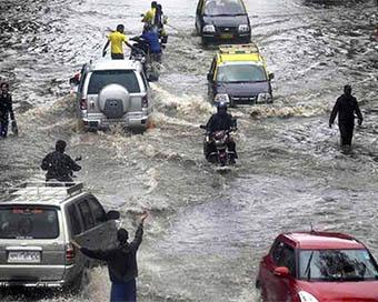 Torrential rainfall paralyses Mumbai; streets, rail tracks flooded (PICS)