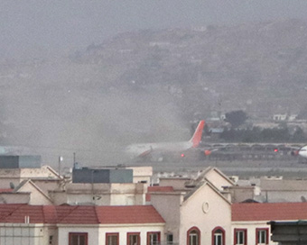 Suicide blasts rock Kabul airport, at least 60 dead (PHOTOS)