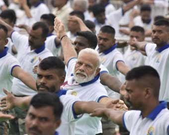 Modi performs yoga with 30,000 people in Ranchi